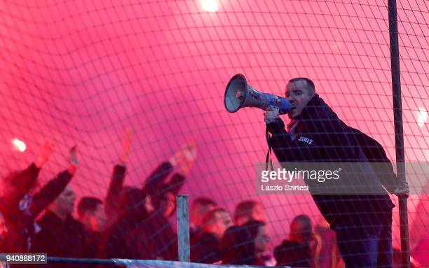 An ultra supporter of Ujpest FC holds a megaphone and cheers on the team during the Hungarian OTP Bank Liga match between Ujpest FC and Ferencvarosi...