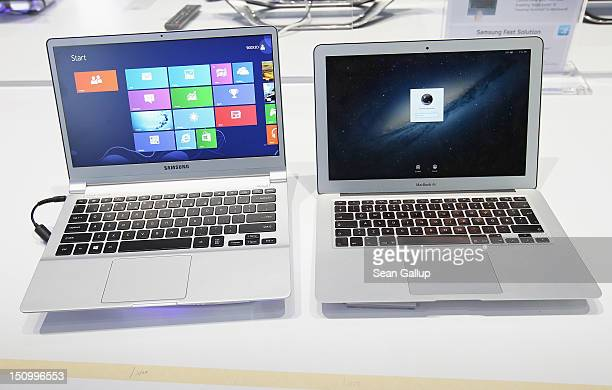 An ultra thin Samsung Notebook Series 9 laptop computer runnung Microsoft Windows 8 sits next to an Apple Macbook Air brought by a visitor during a...