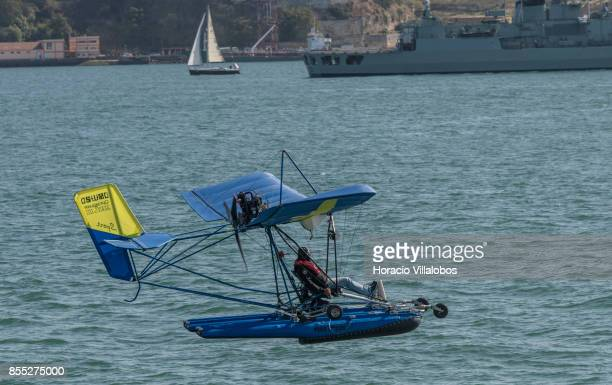 An ultralight amphibious airplane flies over Tagus River during the commemoration of the 100th anniversary of Portuguese Naval Aviation on September...