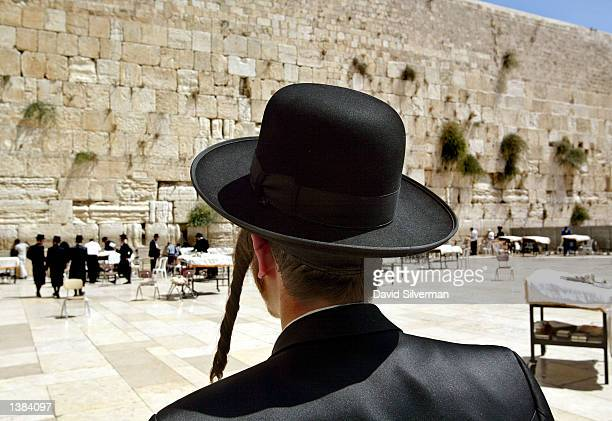 An ultraOrthodox Jew approaches Judaism's holiest site the Western Wall in Jerusalem's Old City to pray for forgiveness before the start of Yom...