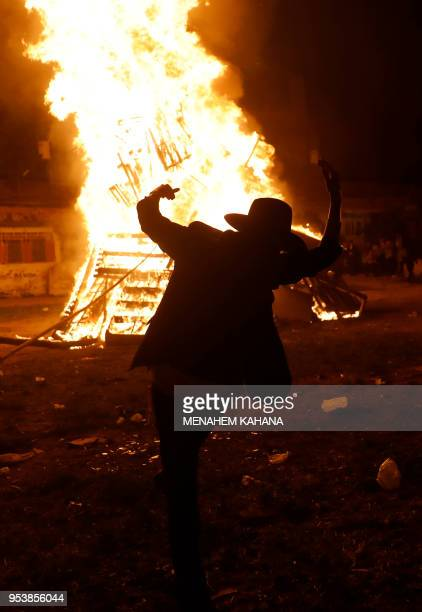An UltraOrthodox Jew dances around a bonfire in Jerusalem's UltraOrthodox Mea Shearim neighbourhood on May 2 during celebrations for the Jewish...