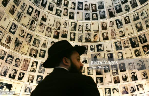 An ultra-Orthodox Jew looks at photographs of Jewish victims of the Nazis in the Hall of Names exhibit in the Yad Vashem Holocaust Memorial museum...