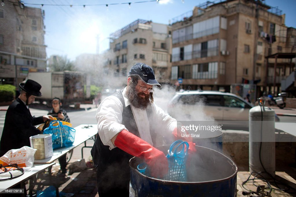 An ultra-Orthodox Jew takes part in the ritual of purifying kitchen utensils in boiling water to make them kosher for Pesach (Passover) on March 24, 2013 in Bnei Brak, Israel. Religious Jews throughout the world eat matzoth during the eight-day Passover, or Pesach, holiday, The Jewish holiday commemorates the Israelis' exodus from Egypt some 3,500 years ago and their ancestors' plight by refraining from eating leavened food. Passover begins March 25 and ends on the evening of April 02.