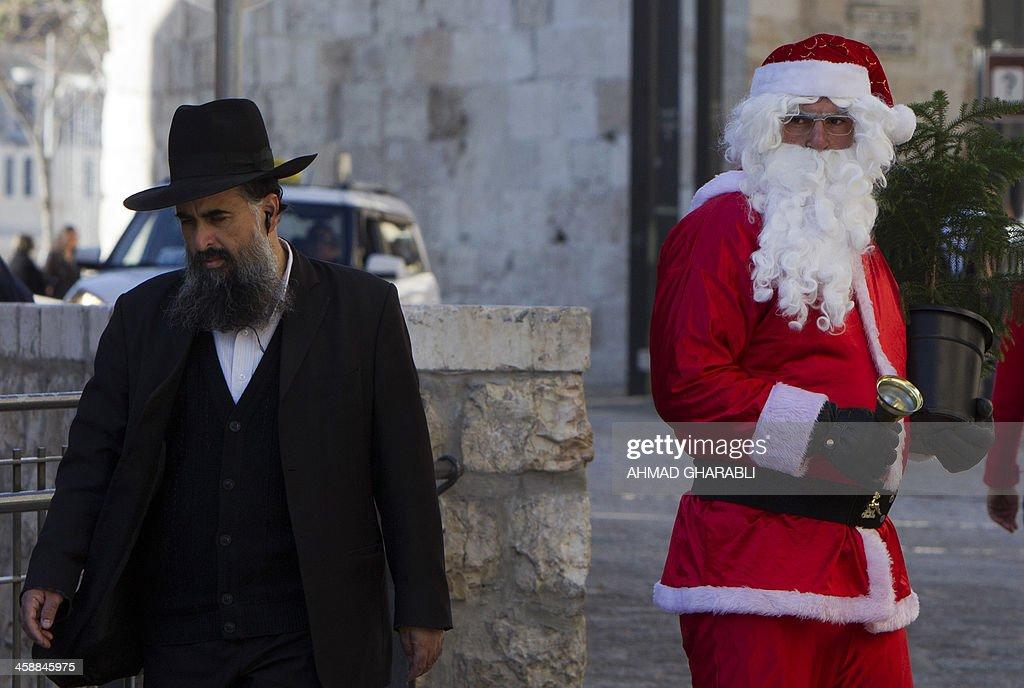 An Ultra-Orthodox Jew walks past a Palestinian man dressed up as ...