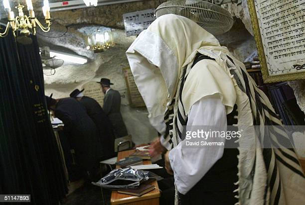An ultraOrthodox Jew wears a Tallit as he prays in the cave tomb of Rabbi Shimon HaTzadik one of the earliest high priests of the biblical Second...