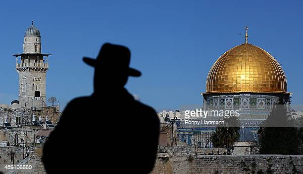 An ultraOrthodox Jew with his hat in front of the AlAqsa mosque the Old City of Jerusalem in Israel on November 16 2014 in Jerusalem Israel