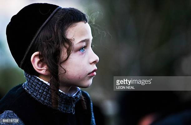 An ultraOrthodox Jewish boy attends a religious Hasidic wedding celebration in the heart of Jerusalem on February 3 2009 The Hasidic sect is a Jewish...