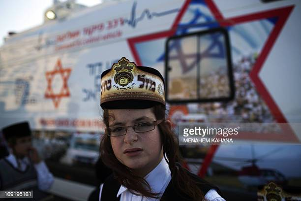 An UltraOrthodox Jewish boy wears a crown written on it in Hebrew Good Luck attends the wedding ceremony of Rabbi Shalom Rokach the Grandson of the...