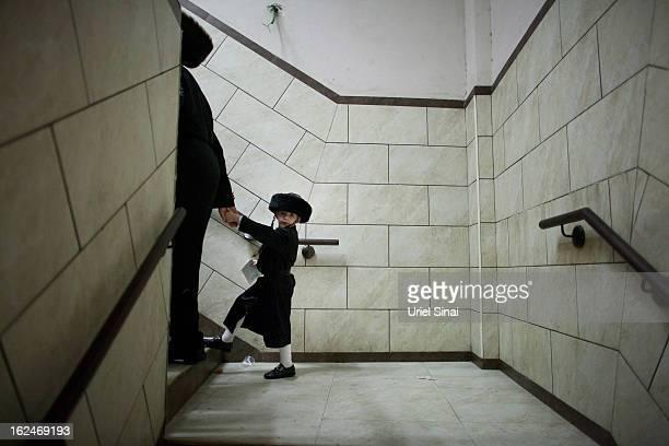 An UltraOrthodox Jewish child wears a costume as jews mark Purim on February 23 2013 in Bnei Brak IsraelThe carnivallike Purim holiday is celebrated...