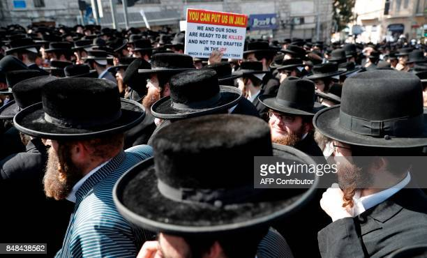 An ultraOrthodox Jewish demonstrator holds a banner during a protest against a court ruling that could require them to serve in the army like their...