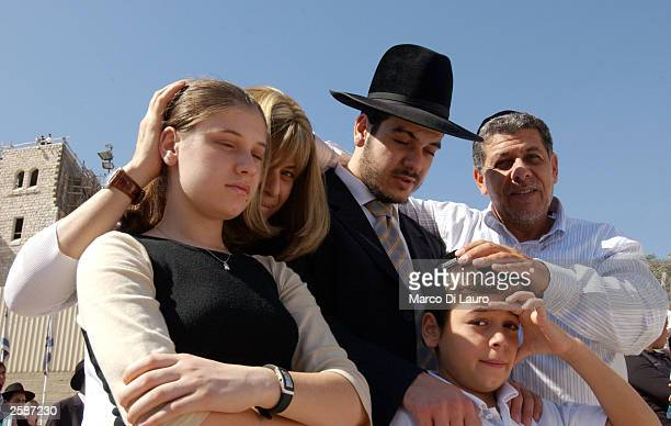 An Ultraorthodox Jewish family pray together during the ritual of the Kohanim at the Western Wall during the celebration of the Jewish festival of...