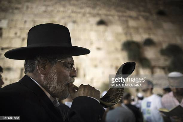 An Ultraorthodox Jewish man blows a 'Shofar' as religious Jews participate in the Slichot prayer at the Western Wall Judaism's holiest site in the...