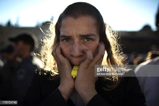 An UltraOrthodox Jewish man blows a whistle during a protest against members of the liberal Jewish religious group Women of the Wall wearing...