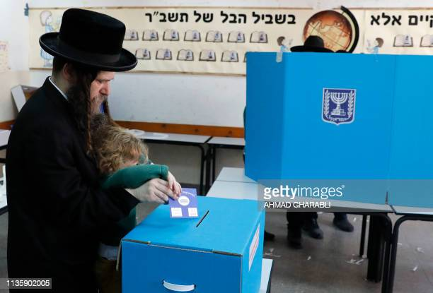 An ultraOrthodox Jewish man casts his vote during Israel's parliamentary elections on April 9 2019 in the Israeli city of Bnei Brak near Tel Aviv...