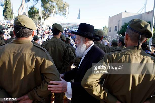 An ultraOrthodox jewish man greets volunteers during a military graduation ceremony on May 26 2013 in Jerusalem Israel The Netzah Yehuda battalion...