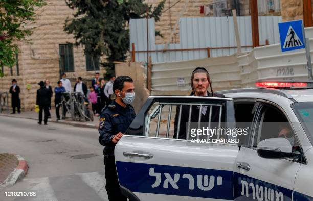 An UltraOrthodox Jewish man is arrested by Israeli security forces as they shut down a synagogue in the Mea Shearim UltraOrthodox neighbourhood in...