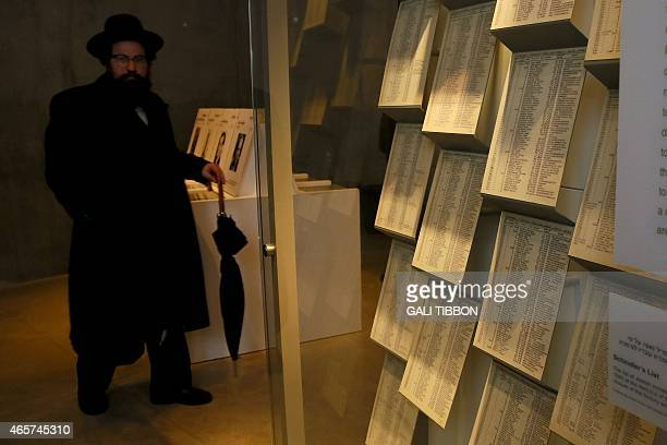 An UltraOrthodox Jewish man looks at facsimiles of Oskar Schindler's lists displayed for the public at the Yad Vashem Holocaust memorial museum in...