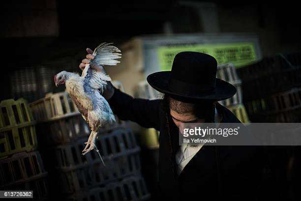 An UltraOrthodox Jewish man performs the Kaparot ceremony on October 10 2016 in Jerusalem Israel It is believed that the Jewish ritual which involves...