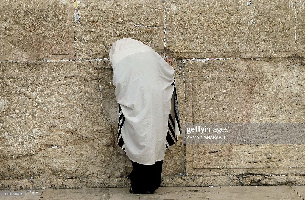 An ultra-Orthodox Jewish man prays in front of the Western Wall, Judaism's holiest prayer site, in Jerusalem's Old City, on October 22, 2012.