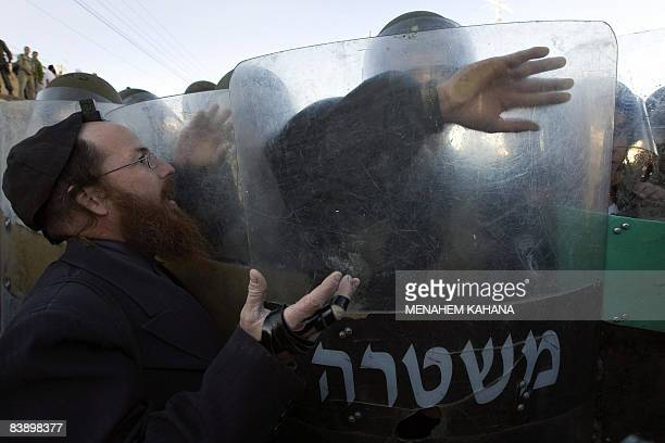 An UltraOrthodox Jewish man shouts at Israeli border policemen after clashes erupted near a disputed house in the flashpoint West Bank city of Hebron...