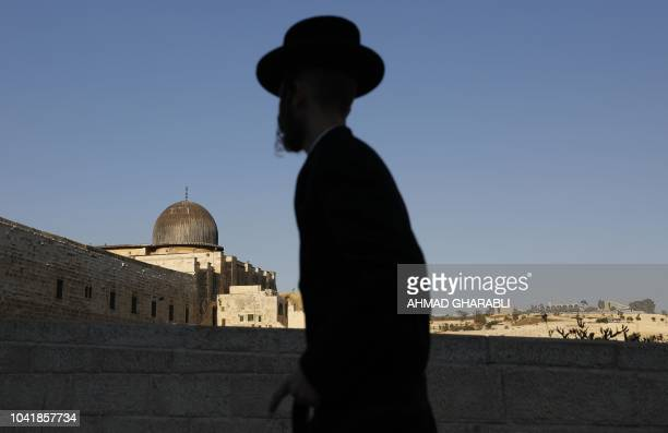 TOPSHOT An UltraOrthodox Jewish man stands at the Jewish quarter in Jerusalem's Old City overlooking alAqsa Mosque on September 27 2018 Comments by...