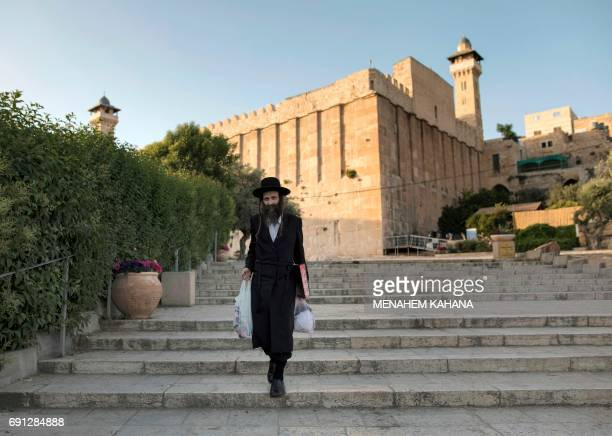 An Ultraorthodox Jewish man walks outside the Patriarchs' Tomb known in Arabic as the Ibrahimi Mosque in the the divided West Bank city of Hebron on...