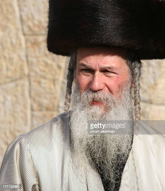 CONTENT] An UltraOrthodox Jewish man with long Payots beard and a Shtreimel looking with his eyes narrowed Te photo was taken at the Western Wall of...