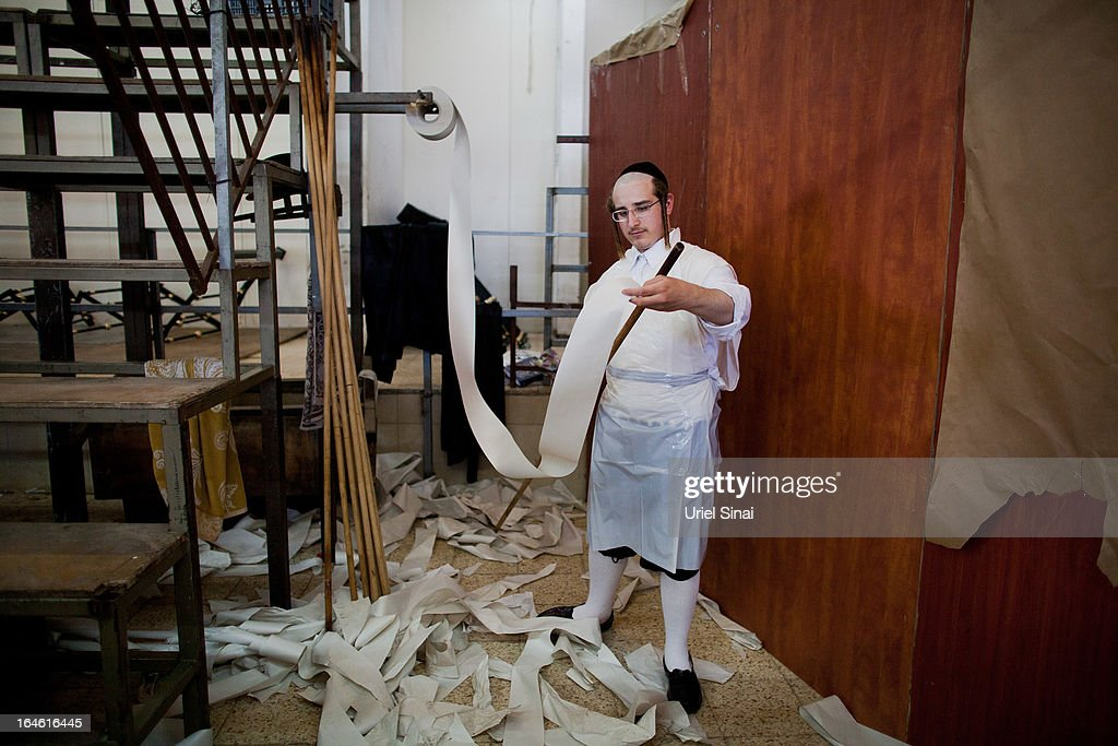 An Ultra-Orthodox Jewish man wraps a stick with paper before preparing the Matzoth, or unleavened bread, in a final preparation before the start at sundown of the Jewish Pesach (Passover) holiday on March 25, 2013 in Bnei Brak, Israel. Religious Jews throughout the world eat matzoth during the eight-day Passover, or Pesach, holiday, The Jewish holiday commemorates the Israelis' exodus from Egypt some 3,500 years ago and their ancestors' plight by refraining from eating leavened food. Passover begins March 25 and ends on the evening of April 02. (Photo by Uriel Sinai/Getty Images