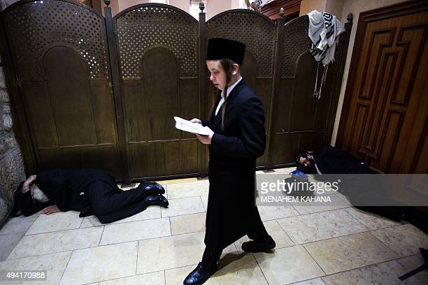 An ultraOrthodox Jewish pilgrim prays at Rachel's Tomb Judaism's third holiest shrine located in the West Bank town of Bethlehem on October 25 as...
