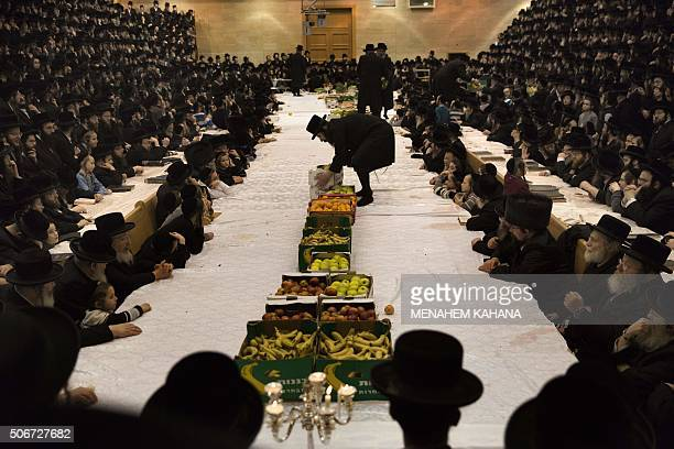 TOPSHOT An UltraOrthodox Jewish rabbi of the Belz Hasidim brings boxes of fruits during the celebration of the Jewish feast of Tu Bishvat on January...