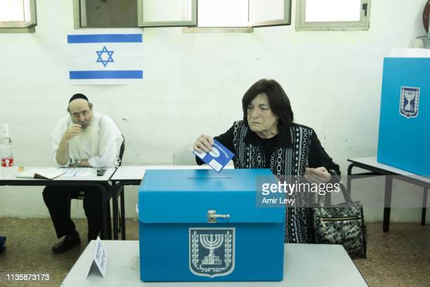 An UltraOrthodox Jewish woman casts her ballot in Israel's general elections on April 9 2019 in Bnei Brak Israel