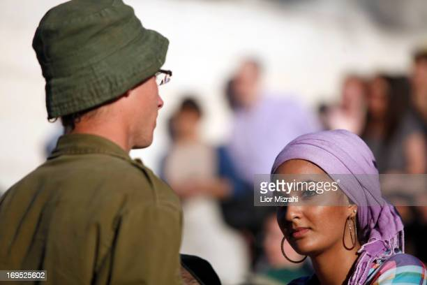 An ultraOrthodox jewish woman looks on during a military graduation ceremony on May 26 2013 in Jerusalem Israel The Netzah Yehuda battalion was...