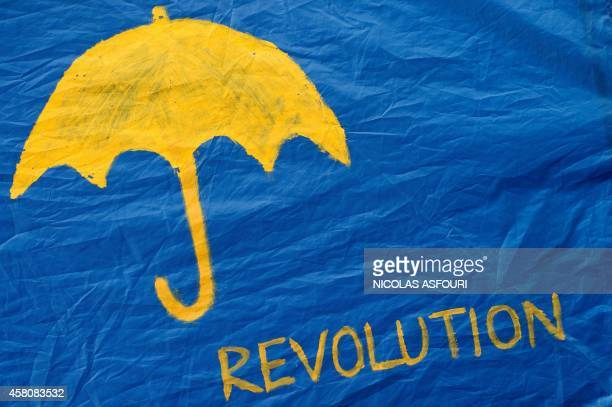 """An umbrella and the word """"revolution"""" is seen on a tent at the pro-democracy camp site in the Admiralty district of Hong Kong on October 30, 2014. A..."""