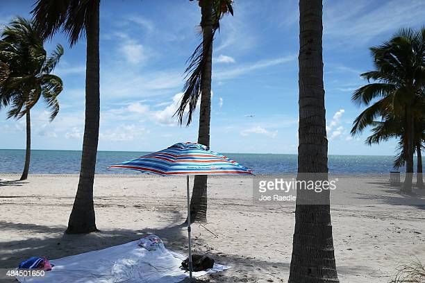 An umbrella is seen on the beach on August 19 2015 in Key Biscayne Florida Numbers released today by the Florida state tourism bureau showed that in...
