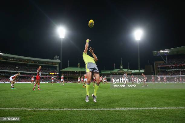 An umpire attempts a boundary throw in during the round three AFL match between the Sydney Swans and the Greater Western Sydney Giants at Sydney...