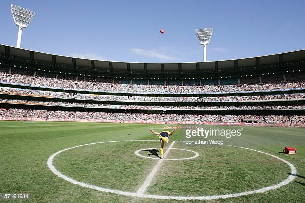 An umpire bounces the ball on the centre of the pitch during the AFL match between Collingwood and St Kilda at the MCG on May 1 2005 in Melbourne...