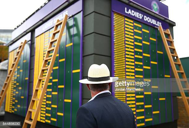 An Umpire looks on at the score board on day seven of the Wimbledon Lawn Tennis Championships at the All England Lawn Tennis and Croquet Club on July...