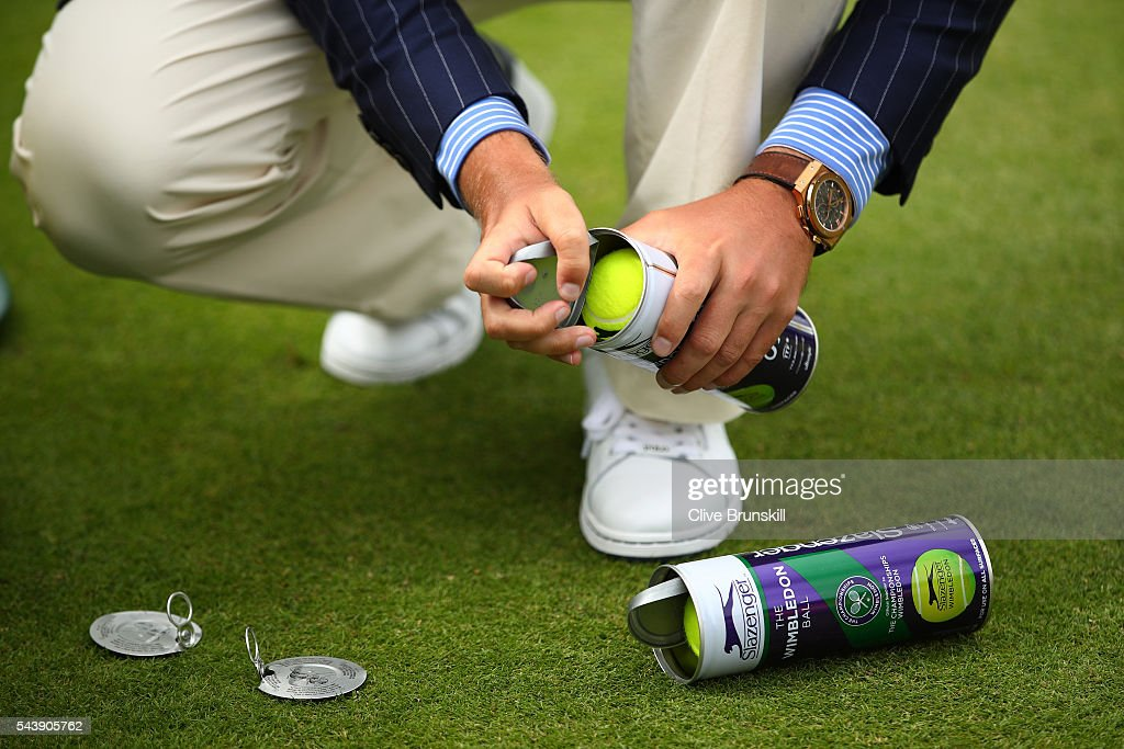 An umpire opens a new tin of tennis balls on day four of the Wimbledon Lawn Tennis Championships at the All England Lawn Tennis and Croquet Club on June 30, 2016 in London, England.