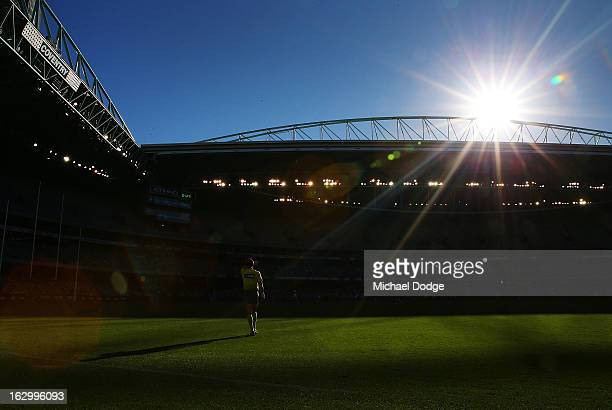 An umpire shields his face from the sun during the round two AFL NAB Cup match between the St Kilda Saints and the Sydney Swans at Etihad Stadium on...