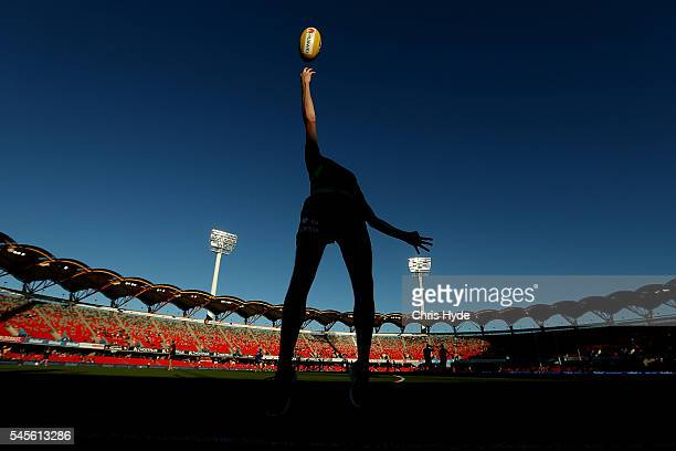 An umpire throws the ball before the round 16 AFL match between the Gold Coast Suns and the Brisbane Lions at Metricon Stadium on July 9 2016 in Gold...