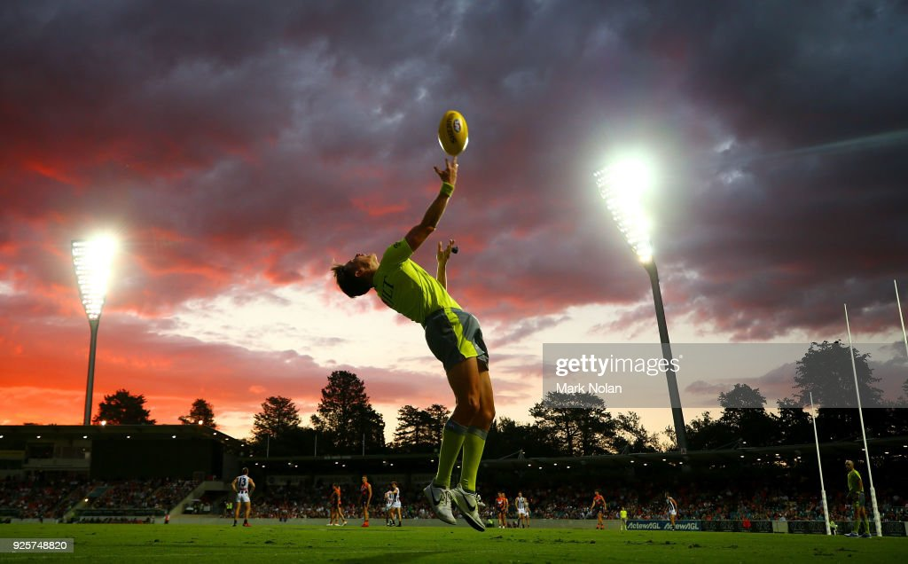 An umpire throws the ball in during the JLT Community Series AFL match between the Greater Western Sydney Giants and the Collingwood Magpies at UNSW Canberra Oval on March 1, 2018 in Canberra, Australia.