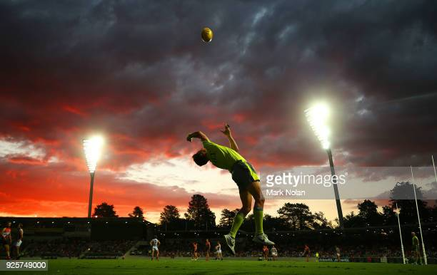 An umpire throws the ball in during the JLT Community Series AFL match between the Greater Western Sydney Giants and the Collingwood Magpies at UNSW...