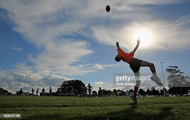 An umpire throws the ball into play during the Yarra Valley Mountain District Football League Division 1 Seniors Preliminary Final between Wandin and...