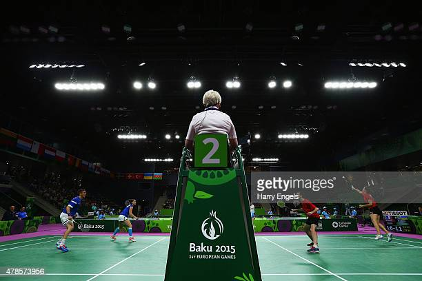 An umpire watches the play during the Badminton Mixed Doubles quarter final match between Gaetan Mittelheiser and Audrey Fontaine of France and...