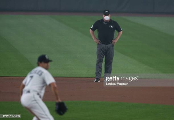 An umpire wears an N95 style mask during poor air conditions due to wildfire smoke during the game between the Seattle Mariners and the Oakland...