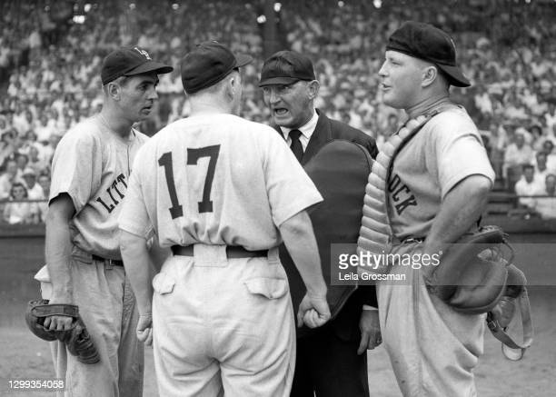 An umpire yells at players for the Little Rock Travelers during their minor league baseball game with the Nashville Vols at Sulphur Dell Stadium...
