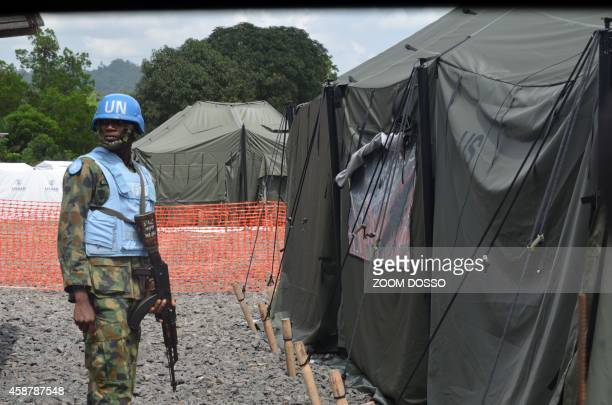 An UN soldier stands in front of a tent in the new Ebola Treatment Center US built by the United States army on November 10, 2014 in Tubmanburg, the...
