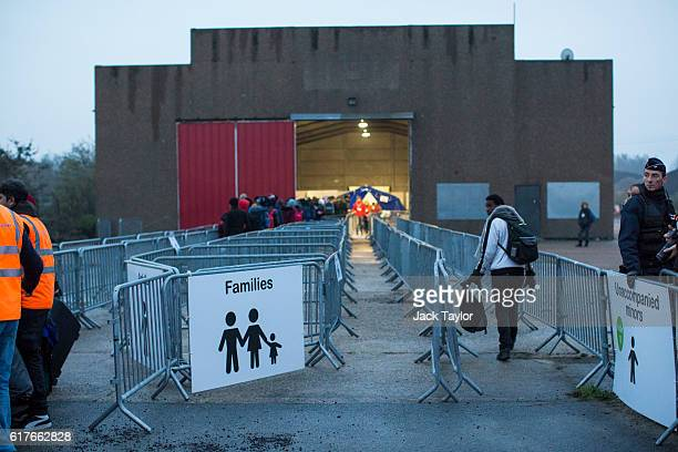 An unaccompanied minor enters a reception point outside the Jungle migrant camp as migrants are processed before boarding buses to refugee centres...
