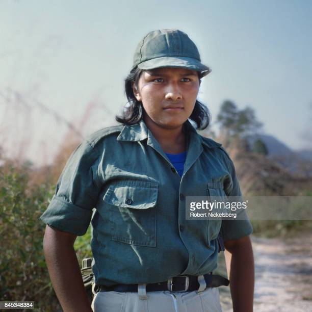 An unarmed guerrilla from the Fuerzas Populares de Liberation or People's Revolutionary Army stops for a picture before moving to his base below the...