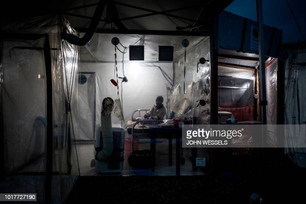 An unconfirmed Ebola patient rests inside a Biosecure Emergency care Unite in the new Ebola Treatment Centre on August 15 2018 in Beni The new ETC...